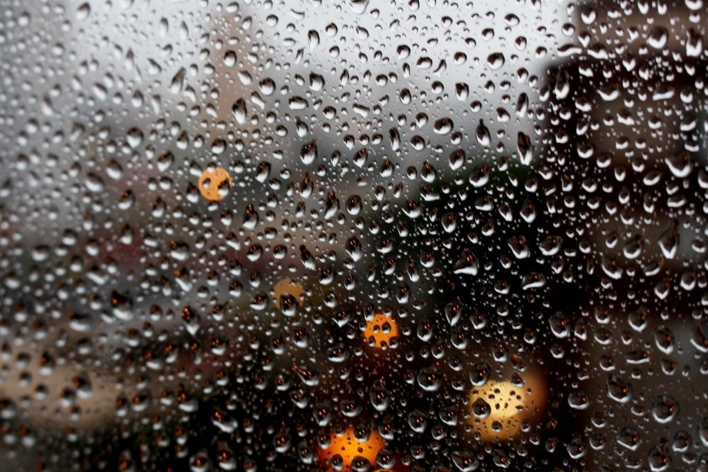 Rainwater collecting on a window pane